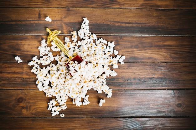 Oscar statuette lying in popcorn
