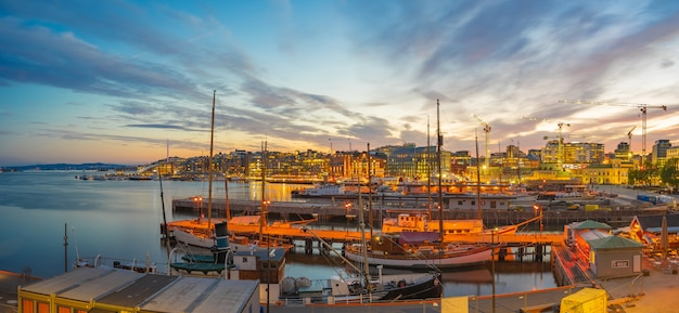 Oslo cityscape at night with view of port in oslo city, norway
