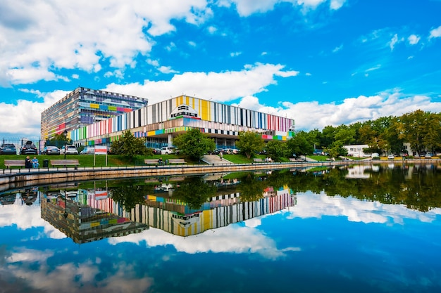 Ostankino television studio building and its reflection in the pond