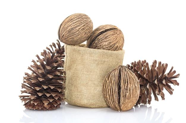 Othalanga - suicide tree seed and cedar pine cone in sacks fodder