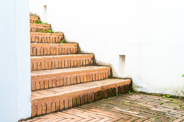 Ourdoor brick stair step with white wall