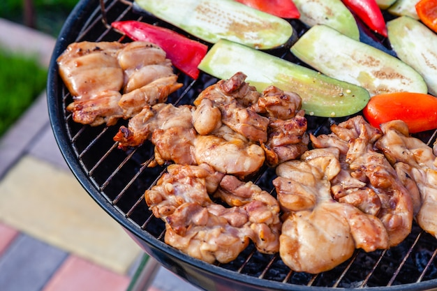 Outdoor barbeque. grilled chicken meat fillet, vegetables, red pepper, zucchini