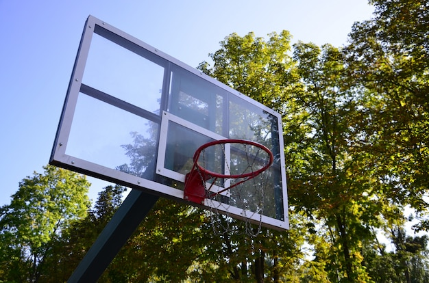 Outdoor basketball backboard with clear blue sky