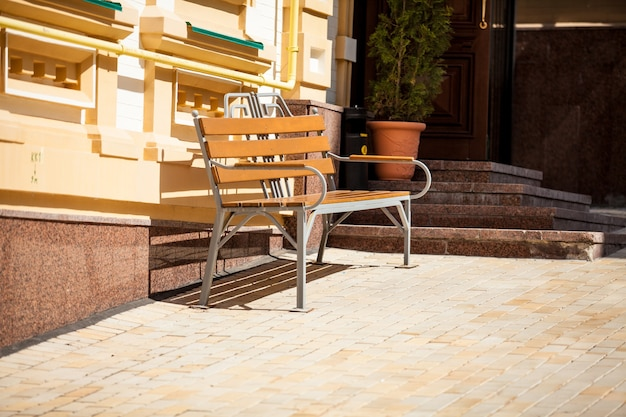 Outdoor of bench on street at sunny day