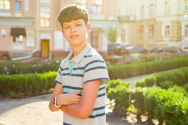 Outdoor boy with crossed arms