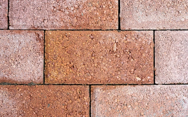 Outdoor brown block stone floor pattern and background seamless, floor tiles background top view