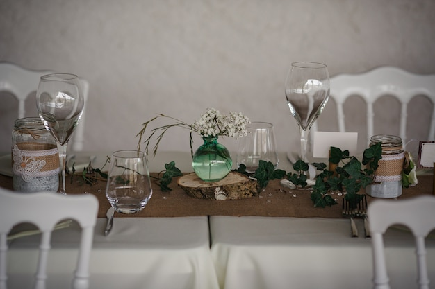 Outdoor catering dinner at the wedding with homemade garnishes decoration