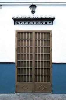 Outdoor closed door in a spanish cafe