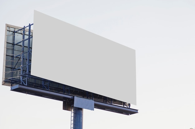 Outdoor empty advertising billboard against white background