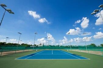 Outdoor empty tennis court with blue sky