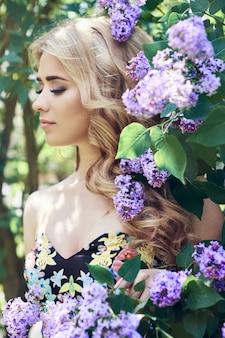 Outdoor fashion beautiful young woman lilac flower
