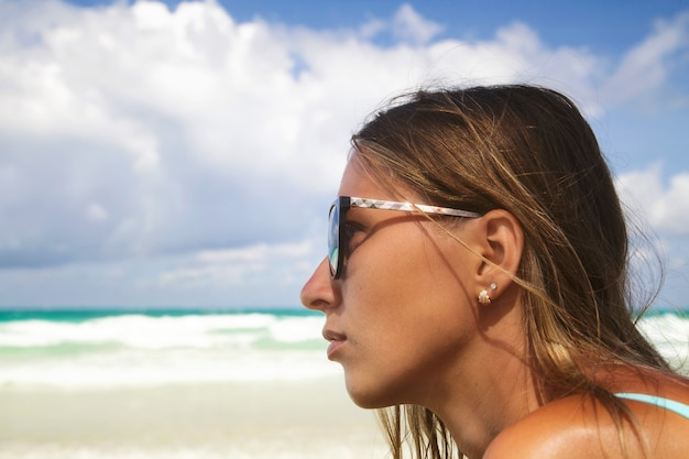 Outdoor fashion portrait of young beautiful woman face in sunglasses