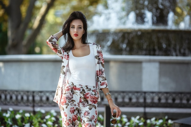 Outdoor fashion street stile portrait of pretty woman in morning city.