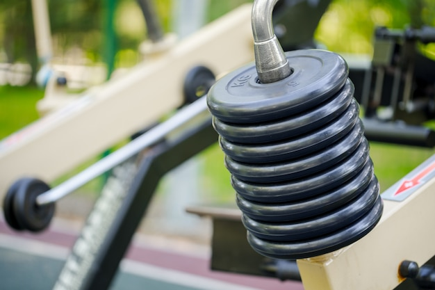 Outdoor fitness gym equipment in public park close up