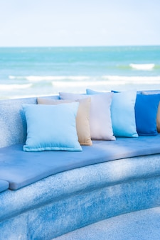 Outdoor patio in the beach with sofa and pillows