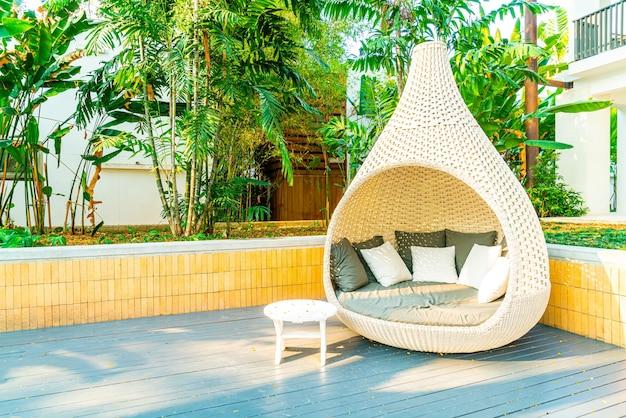 Outdoor patio chair arch in garden