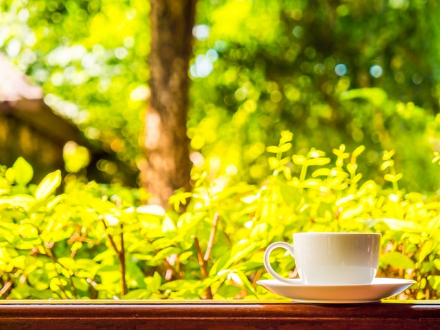 Outdoor patio with beautiful nature view and white coffee cup