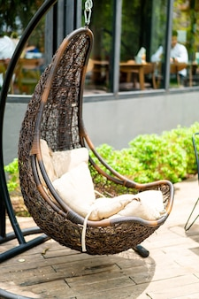 Outdoor patio with wicker swing chair