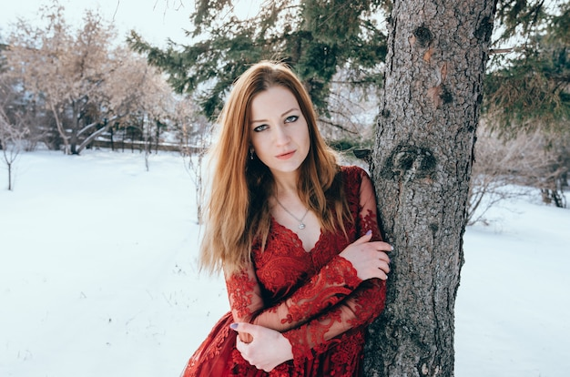 Outdoor photo of romantic lady in red dress