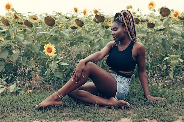 Outdoor portrait of beautiful girl in a field of yellow flowers