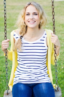 Outdoor portrait of beautiful young woman posing at the park