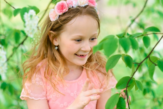 Outdoor portrait of cute little girl in princess dress