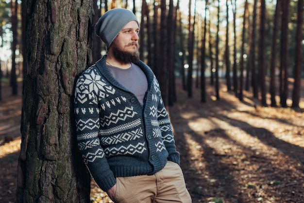 Outdoor portrait of handsome bearded man