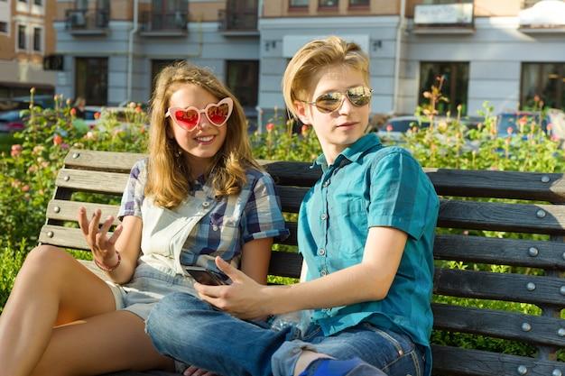 Outdoor portrait of teenage boy and girl