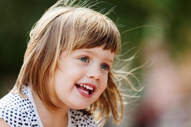 Outdoor portrait of  three-year girl