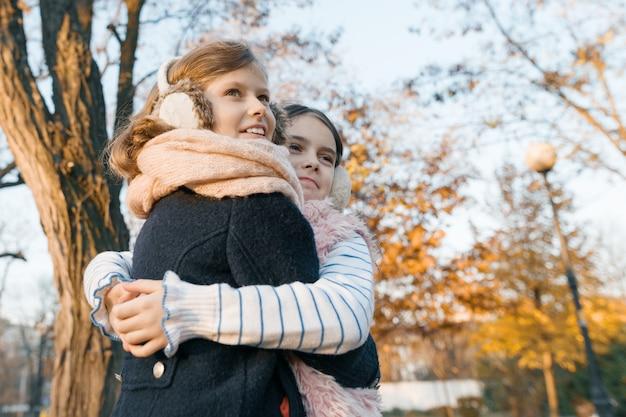 Outdoor portrait of two little girls best friends