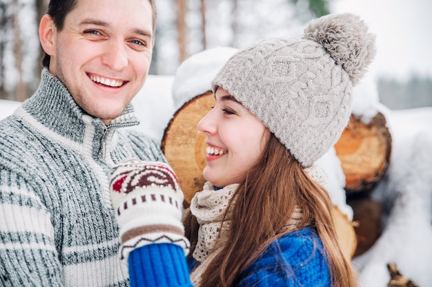 Outdoor portrait of young sensual couple in cold winter wather. love and kiss