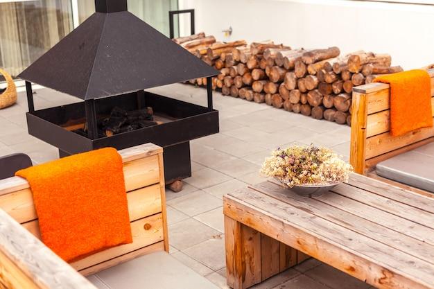 Outdoor restaurant terrace with wooden furniture
