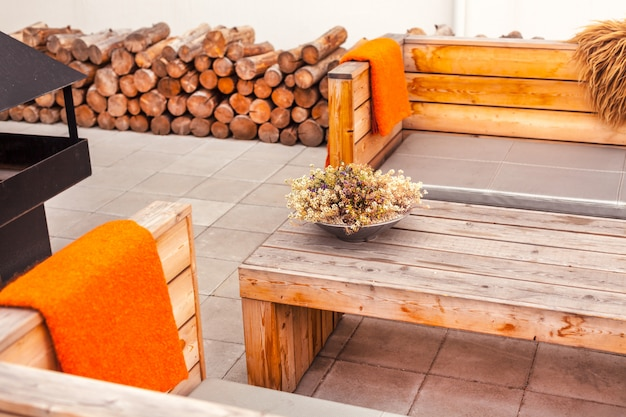 Outdoor restaurant terrace with wooden furniture