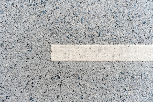 Outdoor road with white line marking on the right side texture.