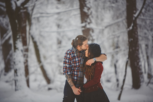 Outdoor seasonal activities. lifestyle capture loving couple walking in snowy winter forest