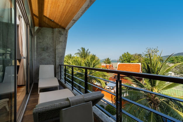 Outdoor seat on balcony with a view in pool villa, house, home, condo and apartment