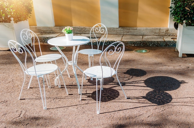 Outdoor summer cafe in classic style sun