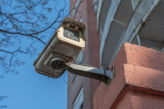 Outdoor surveillance or security camera installed on the external wall of a building. concept security, remote surveillance, surveillance.