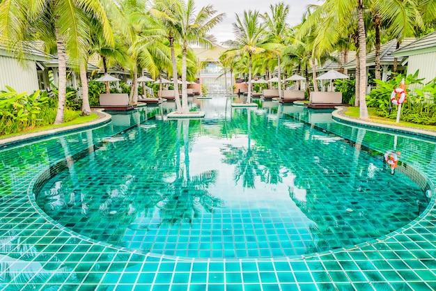 Outdoor swimming pool in hotel resort for summer vacation