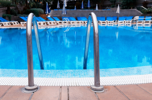 Outdoor swimming pool with stair at hotel. relax and vacation concept.