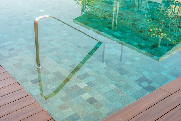 Outdoor swimming pool with stair ladder around there