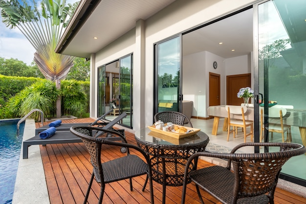 Outdoor table by swimming pool in a luxury home