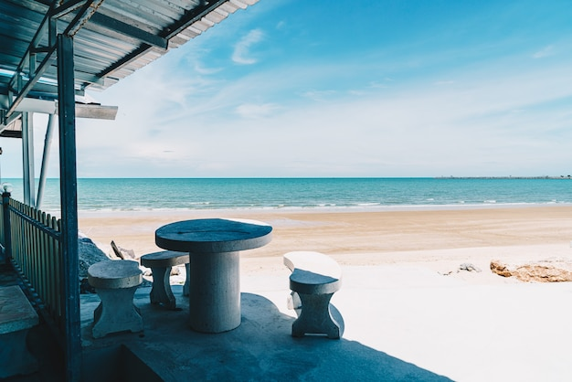 Outdoor table and chair with sea beach and blue sky