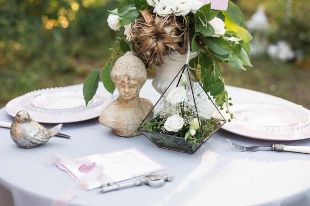 Outdoor vintage wedding decor, bouquet of flowers, a florarium with roses
