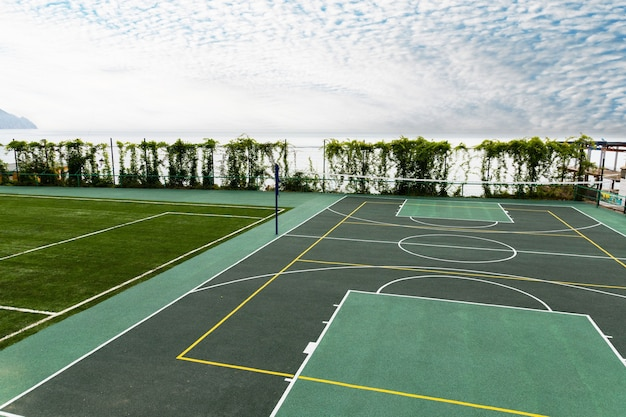 Outdoor volleyball court with a net in the morning next to the sea.