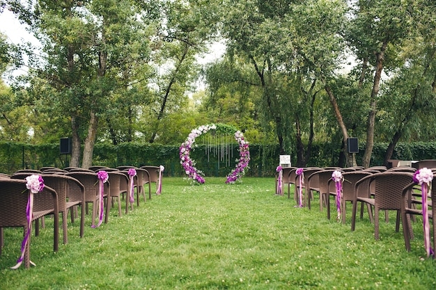 An outdoor wedding ceremony area. decor elements.