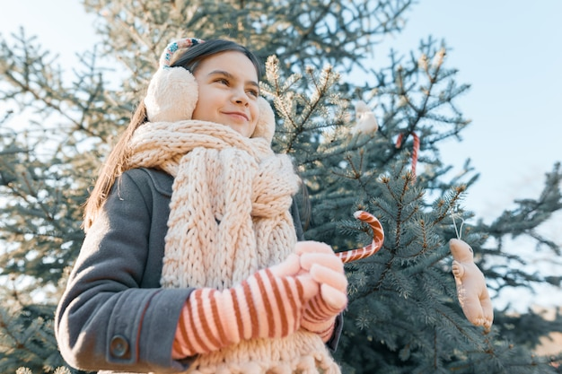 Outdoor winter portrait of a smiling little girl
