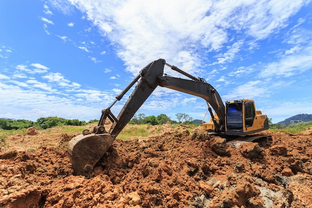 Outdoor work: excavator digging to moving the soil