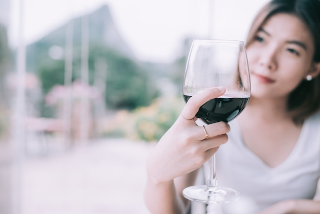 Outdoors portrait of a beautiful wine tasting tourist woman.young woman drinking wine