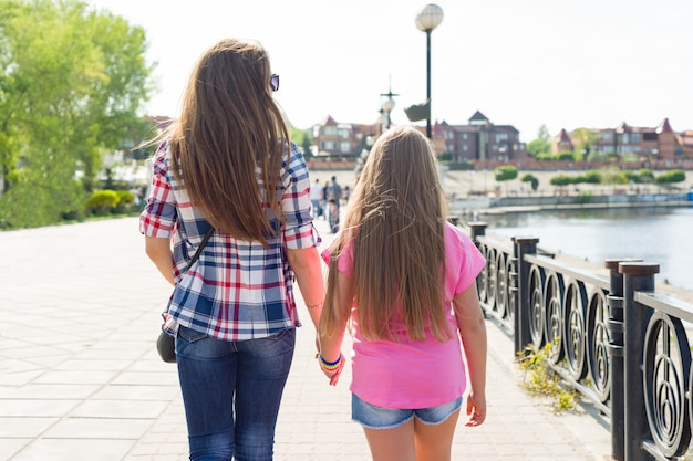 Outdoors portrait of mother and daughter